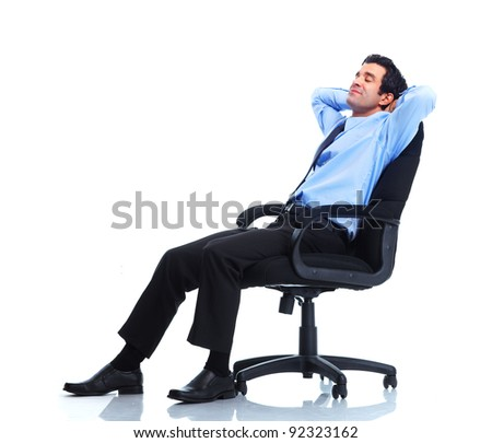 Relaxing handsome businessman. Isolated over white background. - stock photo