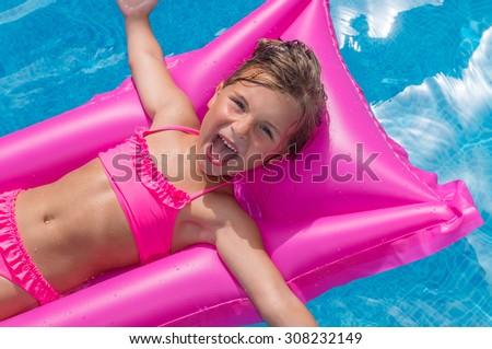 relaxing happy little female kid - stock photo