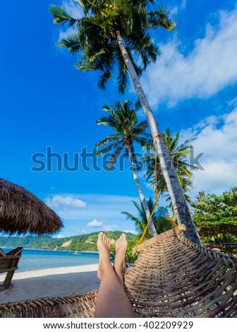 Relaxing in a hammock - stock photo