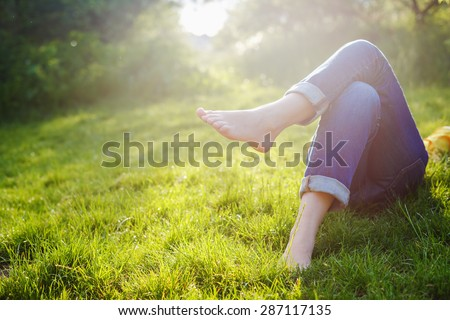 Relaxing in a meadow in the summer sun - stock photo