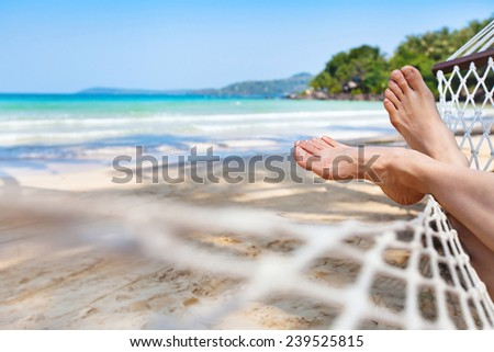 relaxing in hammock on the beautiful paradise beach - stock photo