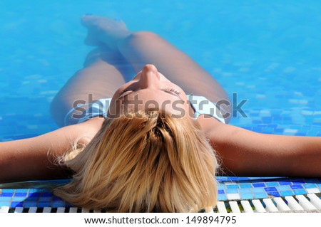 Relaxing in pool. Top view of beautiful young women relaxing in pool with her eyes closed - stock photo