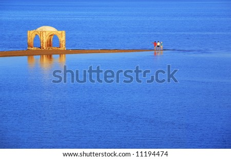 Relaxing in the Red Sea. Old mosque on the water  landscape. Idyllic sunset - stock photo