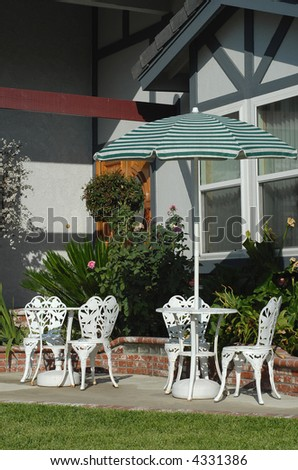 Relaxing lawn table and chairs set - stock photo