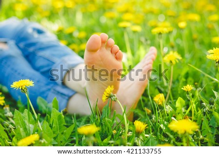 Relaxing lying in a meadow in summer sunshine - stock photo