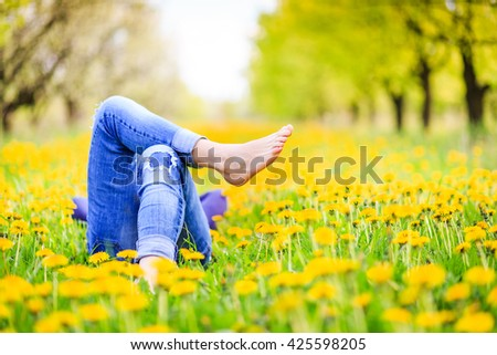 Relaxing lying in a meadow in summer sunshine