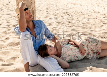 relaxing midday on the beach - stock photo