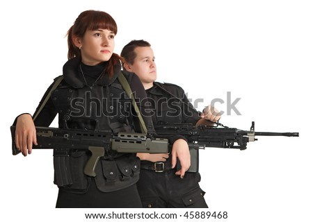 Relaxing military woman with the machine gun. Military man on the background. Focus point on the woman. - stock photo