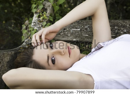 relaxing on a bench - stock photo