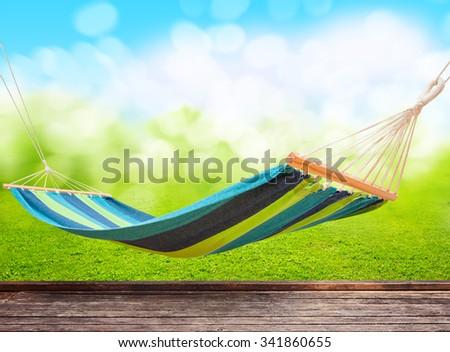 Relaxing on hammock in garden - stock photo