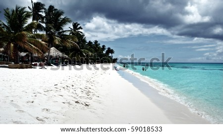 Relaxing on remote beach - stock photo