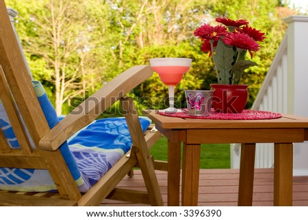 relaxing on the backyard deck - stock photo