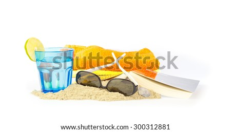 Relaxing on the beach with a good book something to drink - stock photo