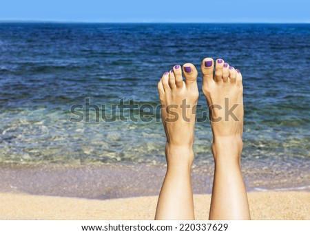 Relaxing on the beach with legs up. Sexy legs - stock photo