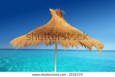 Relaxing on Tropical Beach under umbrella on sunny day - stock photo