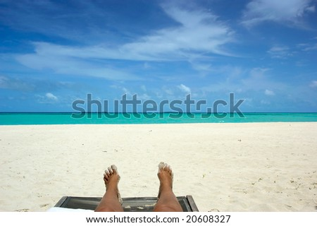 relaxing on tropical white beach - stock photo