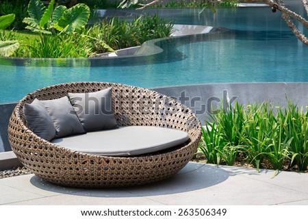 Relaxing Rattan Sofa At Swimming Pool - stock photo
