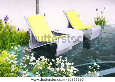 Relaxing seats and plants - stock photo