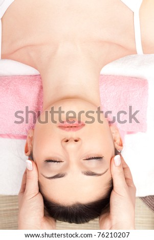 relaxing spa massage of head at spa salon - stock photo