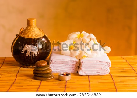 Relaxing spa massage with a candle warm light. - stock photo