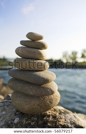 Relaxing Stone Tower outdoor with water in background