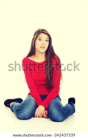 Relaxing student woman sitting on the floor. - stock photo
