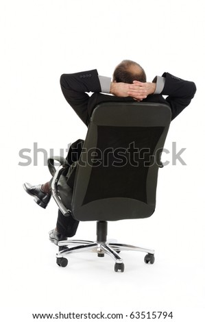relaxing successful businessman leaning back - stock photo