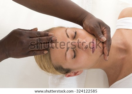 Relaxing therapy: Portrait Of Young Beautiful Woman Receiving He - stock photo