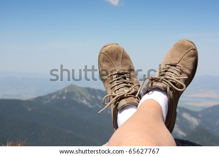 Relaxing time during a trekking in a mountains - stock photo