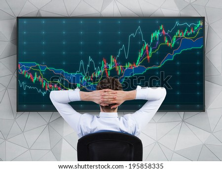 Relaxing trader in front of forex screen - stock photo