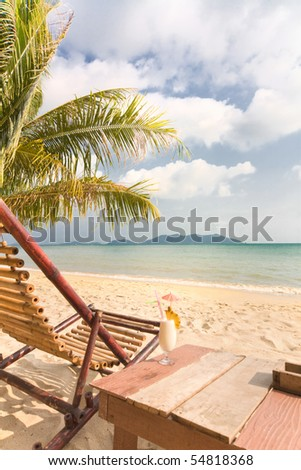 Relaxing under a palm trees with cocktail on loneliness beach. Thailand. Island Koh Chang - stock photo