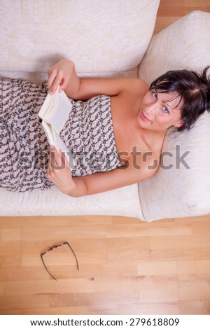 relaxing upside looking younger adult - stock photo