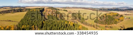 relaxing wavy landscape of northern Czechia in lovely autumn light - panoramic top view - stock photo