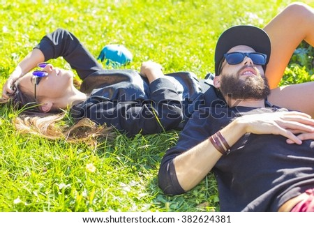 Relaxing with significant other outdoors in the sunshine.