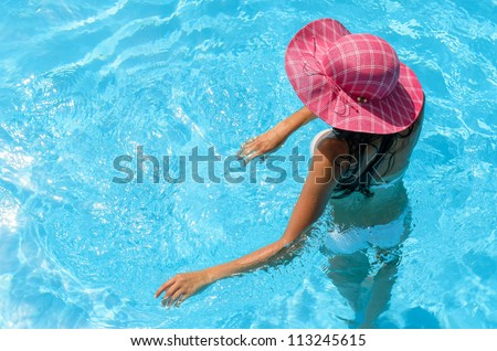 Relaxing woman in pool on summer holiday.  Caucasian woman relaxing into water, Copy space. - stock photo