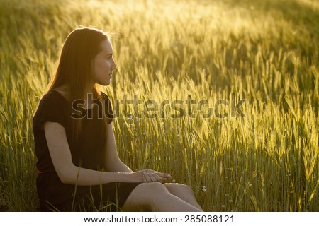 Relaxing woman in summer sunset - stock photo
