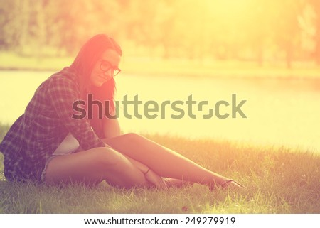 Relaxing woman on grass