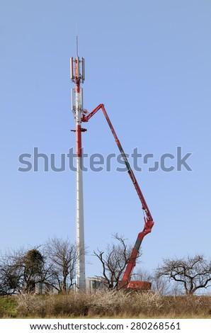 relay antenna installation - stock photo