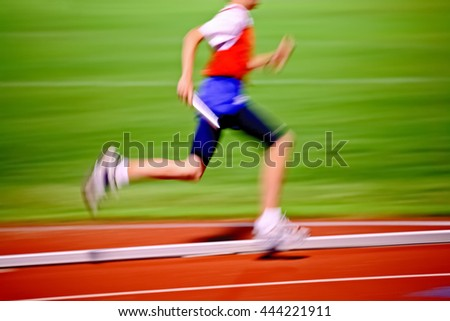 Relay race, motion blurred image of runner.  Track and Field - stock photo