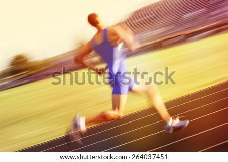 Relay runner - stock photo