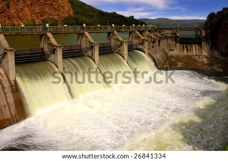 Release of water at a dam wall. - stock photo