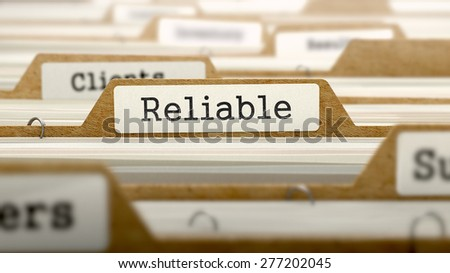 Reliable Concept. Word on Folder Register of Card Index. Selective Focus.