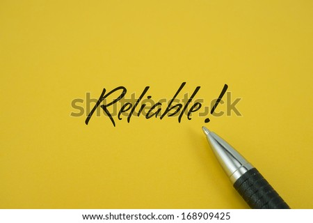 Reliable note with pen on yellow background