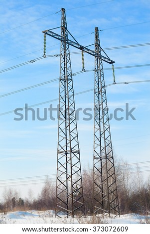 Reliance high-voltage electrical line against the blue sky - stock photo