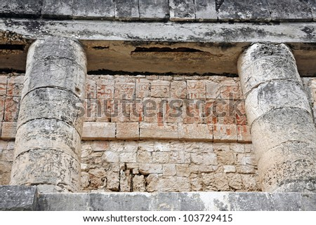 relief details of temple ruins in great ball court of Chichen Itza Mexico - stock photo