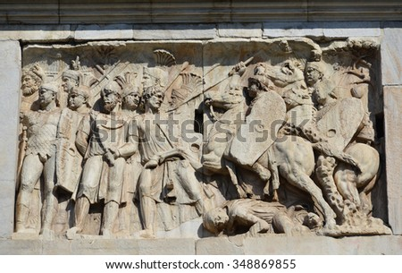 Relief of a battle scene between roman legion and barbarians in the famous Arch of Constantine, Rome (2nd century) - stock photo