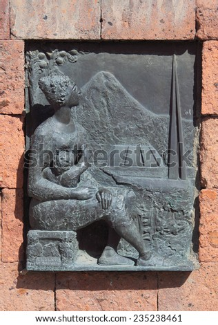 relief picture on building near Etchmiadzin monastery, Armenia. This art object located in public place on open street and the rule of freedom of panorama works in Armenia - stock photo