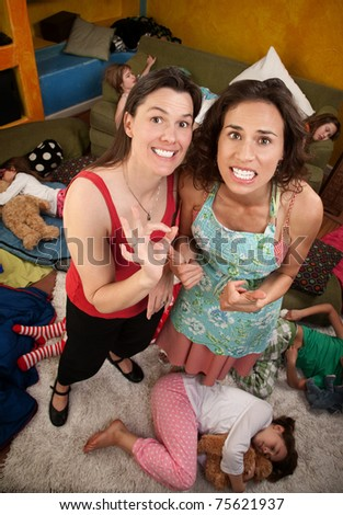 Relieved Moms after the kids fall asleep - stock photo
