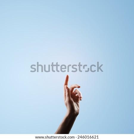 religion concept. finger rising up - stock photo