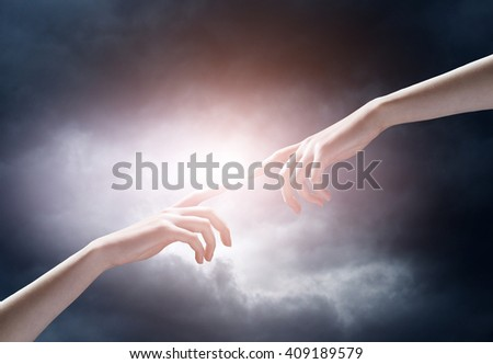 religion concept. finger touching the magic sky - stock photo
